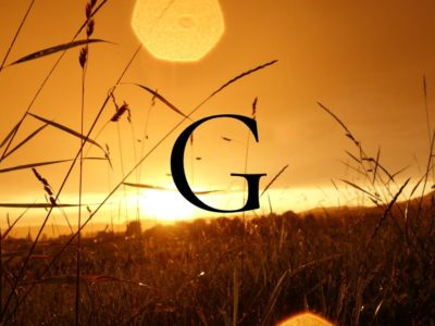 Golden sunset with the letter G overtop