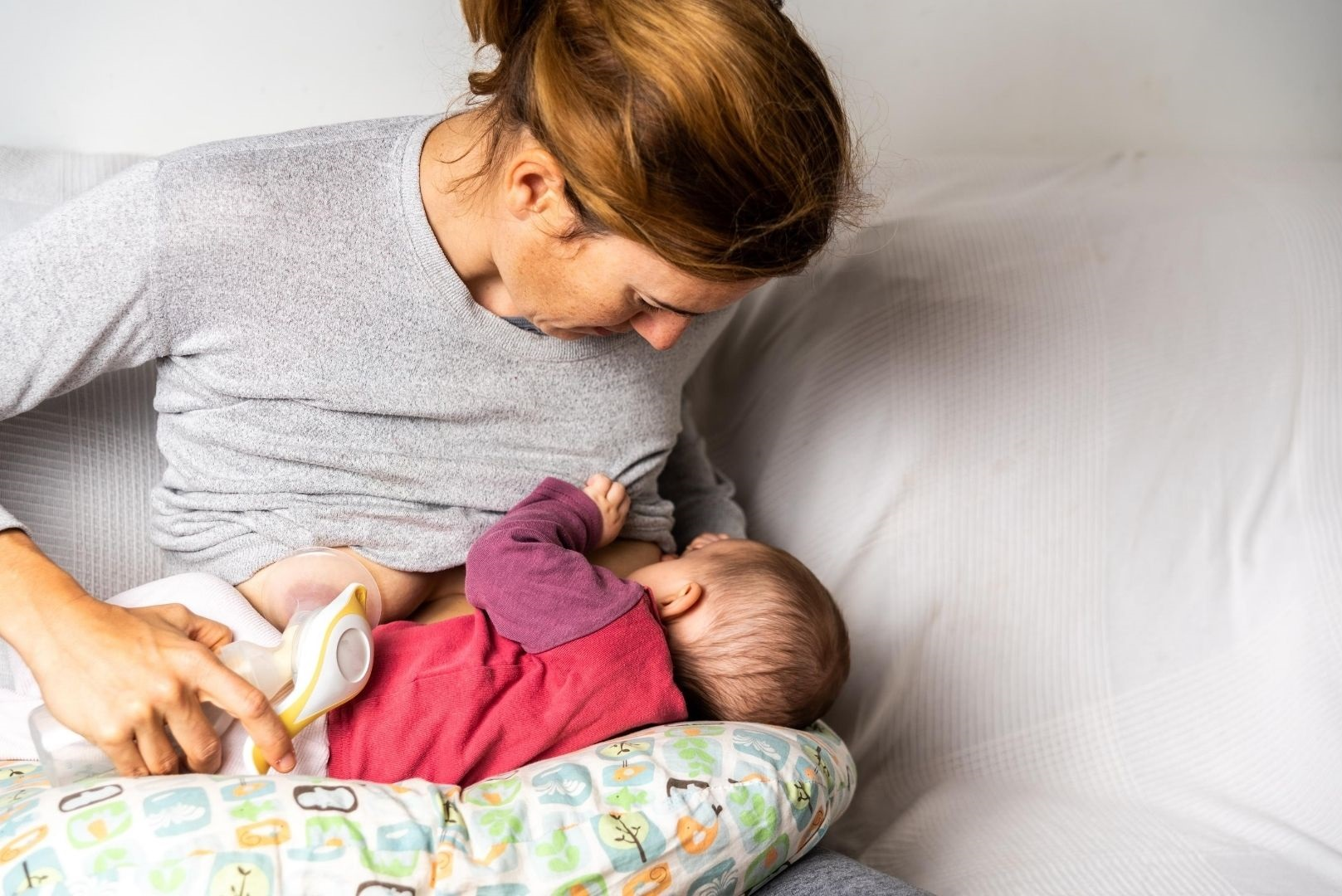 Woman breastfeeding and pumping